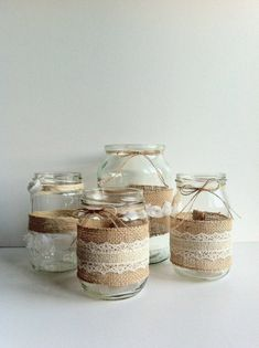 mason jar centerpieces, four different clear jars, decorated with burlap and whi. mason jar centerpieces, four different clear jars, decorated with burlap and whi. Chalk Paint Mason Jars, Painted Mason Jars, Mason Jar Crafts, Mason Jar Diy, Burlap Wedding Decorations, Deco Nature, Diy Hanging Shelves, Mason Jar Flowers, Diy Flowers