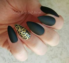 Matte (no shine) black nails with a gold glitter leopard print accent nail. Choose your shape! Stiletto (shown), ballerina/coffin, oval long square or