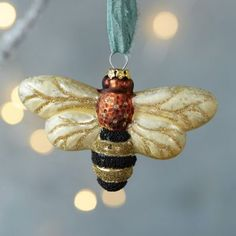 A sweet addition to the tree, this glass ornament is topped with shimmering glitter.- Glass, glitter, fabric hanger- Indoor use only- Hanging loop: Holiday Ornaments, Glass Ornaments, Christmas Decor, Hives And Honey, Honey Bees, Bee Images, Buzz Bee, I Love Bees, Bee Jewelry