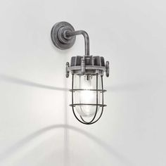 Caged industrial wall light in weathered antique aluminium