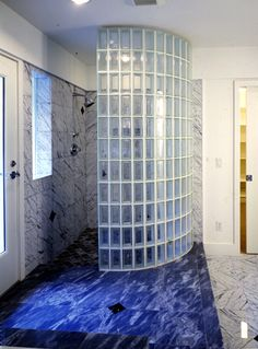 "Masonry built walk-in, door-less Glass Block Shower constructed in mortar with 4""x8"" Glass Block from Pittsburgh Corning designed to look like Glass Brick. Stylecap glass tiles are used to finish the edge of the Glass Block Shower wall."