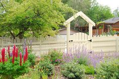 "This is a ""Dancing Picket Fence""  15 Privacy Fences That Will Turn Your Yard Into a Secluded Oasis"