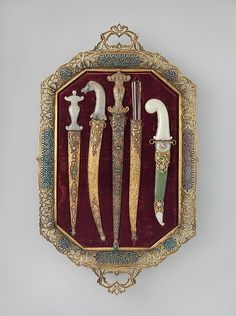 """Tray of Jeweled Daggers, probably late 19th century. Turkish culture. The Metropolitan Museum of Art, New York. Gift of Giulia P. Morosini, in memory of her father, Giovanni P. Morosini, 1923 (23.232.1, .3a, b, .4a, b, .6a, b–.8a, b) 
