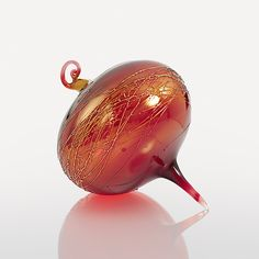 Tango by R. Jason Howard: Art Glass Ornament available exclusively at www.artfulhome.com A dance of crisscrossing threads adds textural interest to this iridised drop of deep vermilion blown glass.