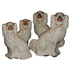Four 19th Century Staffordshire Pottery Dogs