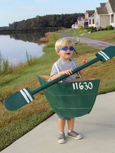 DIY Network shares instructions on how to make a cardboard canoe Halloween costume for kids. Get creative and save money by recycling cardboard to make Halloween costumes. We made this adorable canoe and paddle with just a few boxes, glue and some paint. Diy Carnival, Carnival Costumes, Diy Costumes, Costume Ideas, Easy Homemade Halloween Costumes, Halloween Kostüm, Cardboard Costume, Fancy Dress For Kids, Halloween Disfraces