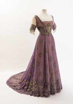 Purple silk chiffon dress belonging to Alexandra, Princess of Wales (1910) Made by Madame Doeuillet, of very fine, heavily embroidered silk chiffon, this dress was most likely unworn, perhaps having been discarded for mourning clothes on Edward VII's death. Fashion Museum UK  Edwardian evening gown, unknown museum, prob around 1908. Mauve silk, metallic embroidery and lace