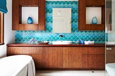 Vanity and turquoise tile