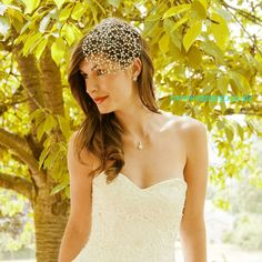 Lois £225 an Ivory and Co design available from www.bridezillas.biz photo by Interlace Photography .
