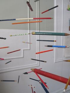 Save pencil stubs.....I have a drill....fishing line.....WOW! pencil mobile