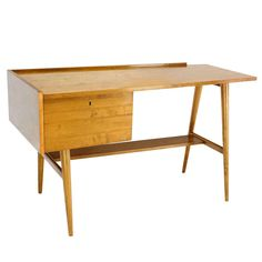 Edmond Spence Mid Century Swedish Modern Blond Maple Desk | From a unique collection of antique and modern desks and writing tables at https://www.1stdibs.com/furniture/tables/desks-writing-tables/