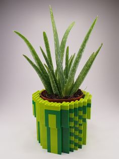 This would be a good DIY project. 8-Bit LEGO Warp Pipe Planter by H.Y. Leung.