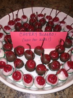 Cherry Bombs! Soaked in vanilla vodka, for 1 day. Drain & let dry in fridge for another day. Dry w/ paper towel & dip in chocolate!