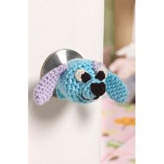 Doggie Doorknob Cozy in Red Heart Soft Solids - LW4181. Discover more Patterns by Red Heart Yarns at LoveKnitting. We stock patterns, yarn, needles and books from all of your favorite brands.