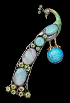 Peacock standing on an opal orb, ca. 1900-- silver & gold with opals and peridot stones  ~ Charles Robert Ashbee (1863-1942),  at Tadema Gallery (London)
