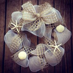 "Sassa Frass Home Decor - 16"" Beach Themed Wreath. Made out of Burlap, Decor Mesh, Twine Netted Ribbon and real Florida shells! $75"