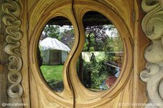 This stunningly beautiful door, surrounded by sculpted cob walls, is in a tiny home that looks out over the banks of a small stream in Somerset, England where the local dialect still has remnants of the Anglo-Saxon language. You can see more pictures of this home and read about building with cob at www.naturalhomes.org/goatlings.htm