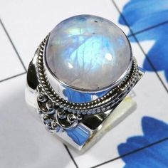 #Rainbowmoonstone #Rainbowmoonstonering Rainbow moonstone Ring at www.CosmoCrafter.com