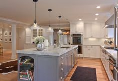 Large kitchen design ideas usually can be easily adapted from older kitchen designs. The new large kitchen design ideas that are become the new trend nowadays is the modern kitchen design. Kitchen With Long Island, Long Kitchen, New Kitchen, Kitchen Decor, Kitchen Islands, Kitchen White, Decorating Kitchen, Kitchen Ideas, Kitchen Photos