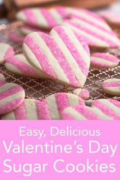 Beautiful striped pink and white heart-shaped Valentine cookies with a little extra sparkle from Preppy Kitchen make for a scrumptious treat! #valentinecookies #bestcookies #bestsugarcookies