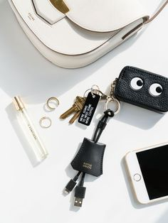 White black and gold a perfect combination. Italian leather KEY cable iPhone charger by Naive Union. Attach the key cable to your bag or keyring, that way you'll never forget your iphone charger. Styling by @alice_gao::