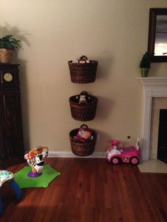 A good way to store baby and kid toys in the living room to keep the dogs out