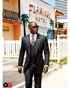 Michael Kenneth Williams: Chairman of the Board: Ultimate Suit Guide: GQ  Wool-cashmere suit, $5570, shirt, $550, and tie, $220, by Tom Ford. Sunglasses by Carrera.