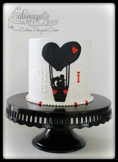 Be Mine. Cake is Dark Chocolate chunk cake with a dark chocolate truffle filling and covered in marshmallow fondant. All decorations are hand cut out of fondant.