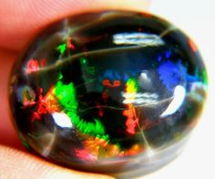 Rare untreated black opal