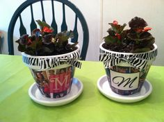 """These flower pots I made for my girls for mothers day. They were so easy. I got the terra cotta pots and saucers at Hobby Lobby and purchased Modge Podge at Walmart. I printed the photos (of my grand babies of course)out at home and Created the """"M's"""" on Mirosoft word. I already had the ribbon on hand from another crafting project. This was a very fun craft, and was so easy."""