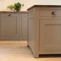 Like the gray-brown color and simple lines of these cabinets.  Floor is boring.
