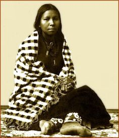 "Portrait of a Sioux woman. Photo taken between 1880 and 1900. The title of this photo is simply called ""Sioux Beauty."""