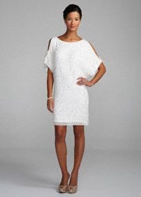 This short cold shoulder sheath is the epitome of chic sophistication. Understated and elegant you are flawless in this dress.   Picture perfect as a reception dress, this beauty features all over beading and sequin accents.  Open sleeves are on trend and add depth to this already striking sheath.  Fully Lined. No Zipper. Spot Clean Only.  Imported.