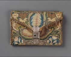 English, late 16th–early 17th century       England Dimensions     Overall: 9 x 14 cm (3 9/16 x 5 1/2 in.) Medium or Technique     Linen; plain weave embroidered with polychrome silk and silver metallic threads; metal clasp and key