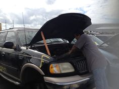 http://www.you-pull-it.com/donate-your-car/ Working on cars at the junk yard