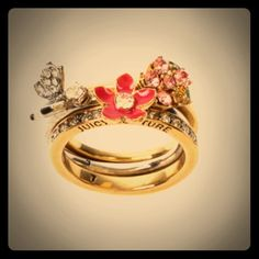 JUICY COUTURE*stacked trio rings*size 8 Butterfly & Flower Encrusted Stacked Rings * - Trio of rings by Juicy Couture * - Floral design with crystal detail * - Engraved signature logo on first ring. Juicy Couture Jewelry Rings