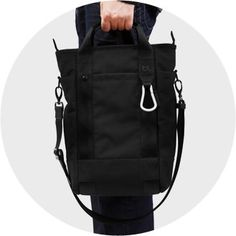 Bluelounge Laptop Tote carried with its handle