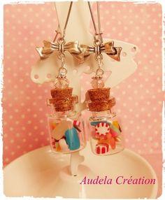 Boucles d'oreilles dormeuses fioles aux doux bonbons à la perle rosé
