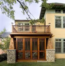 Craftsman style screened porch built under a balcony deck.  Notice the stone work and heavy timber. | houzz.ocm