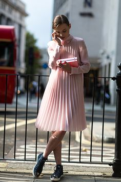 LOVE THIS !   London's Street Style Is Officially Calling. pink collared dress. pleats. sneakers.