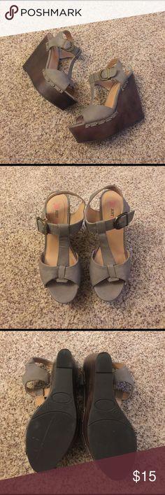"JustFab gray ankle strap wedges sz 8.5 Excellent condition, worn once. Adjustable ankle strap. Open-toed. Studded detail on sides. Dark brown lower wedge, soft gray upper straps. Approximately 5"" heel and 2"" platform. Size 8.5, but fits more like an 8. JustFab Shoes Wedges"
