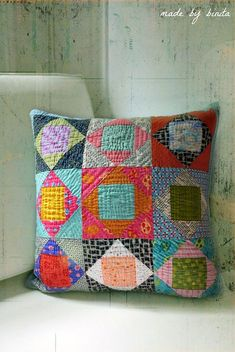 Size: square Fabric: Assorted scraps Technique: paper-pieced blocks, hand-quilted front, machine-quilted back Quilting Designs, Quilting Projects, Sewing Projects, Patchwork Cushion, Quilted Pillow, Small Quilts, Mini Quilts, Pillow Inspiration, Pillow Ideas