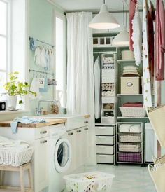 IKEA Laundry Room Storage System the wall length vision makes the room appear larger