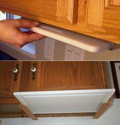 Under the cabinet cutting board #clutterfreekitchen