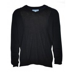 The black thin knit jumper goes over a shirt or underneath a blazer or denim jacket.