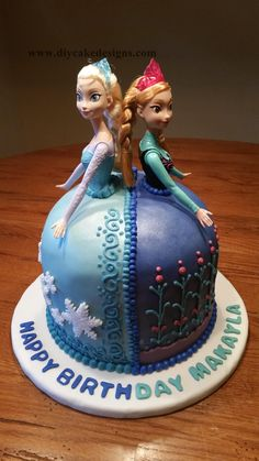 "Disneys ""Frozen"" Elsa and Anna cake --- I'm not a fan of doll cakes in general, but I like the concept of the skirts. It would be great for a tiered/layer cake"