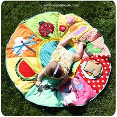 This would be easy to customize...maybe sports for a boy. I think I may make a baseball one for the little guy to use this summer! cute sewing idea. baby picnic blanket craft-bug