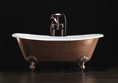 Devon & Devon free-standing cast iron tub with enameled copper finish. I could paint the bottom of my tub this way.