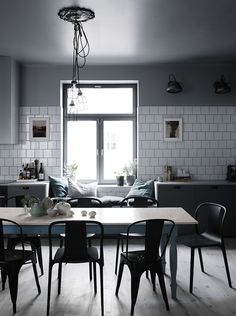 Scandinavian + industrial style kitchen with dining table