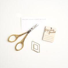 Art Deco Craft Scissors - small antique-style craft scissors with a intricate floral handle design. Gold plated made of stainless steel. Scissors measure about 3 1/2″ long and blade makes a 1″ cut mark. From Oh Hello Friend